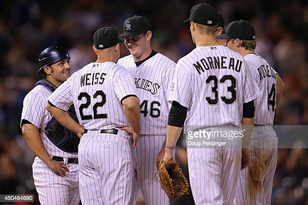 Starting pitcher Tyler Matzek of the Colorado Rockies smiles as he is removed from the game by manager Walt Weiss of the Colorado Rockies in the...