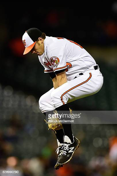 Starting pitcher Tyler Wilson of the Baltimore Orioles jumps in the air behind the pitcher's mound before the start of the fifth inning during a...
