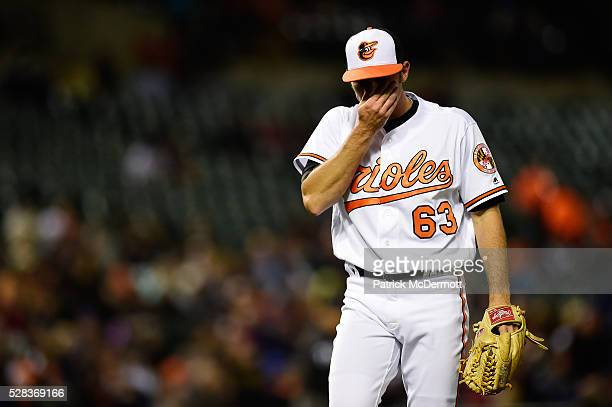Starting pitcher Tyler Wilson of the Baltimore Orioles reacts as he walks to the dugout after the top of the sixth inning during a baseball game...