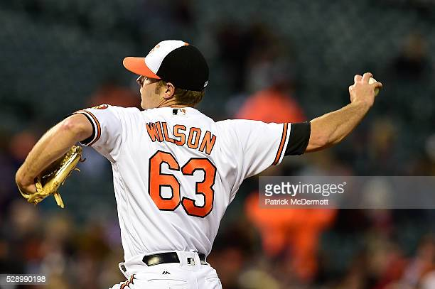 Starting pitcher Tyler Wilson of the Baltimore Orioles throws a pitch to a New York Yankees batter in the third inning during a baseball game at...