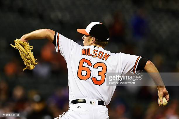 Starting pitcher Tyler Wilson of the Baltimore Orioles throws a pitch to a New York Yankees batter in the fourth inning during a baseball game at...