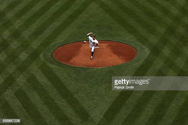 Starting pitcher Tyler Wilson of the Baltimore Orioles works the first inning against the Boston Red Sox at Oriole Park at Camden Yards on May 30,...