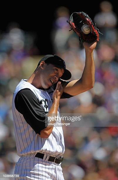 Starting pitcher Ubaldo Jimenez of the Colorado Rockies pauses between pitches as he works against the Cincinnati Reds at Coors Field on September 6...