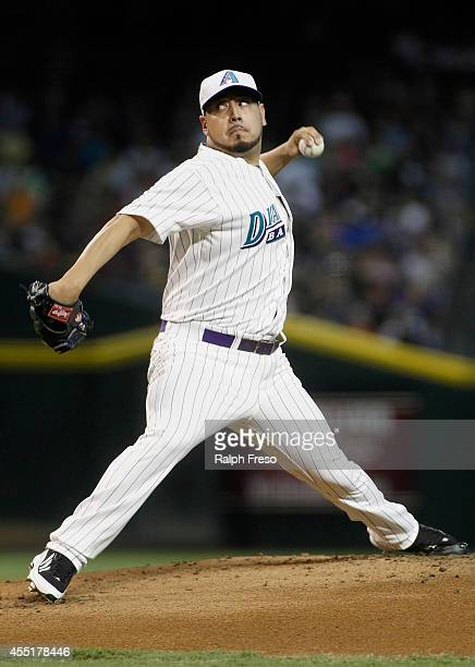 Starting pitcher Vidal Nuno of the Arizona Diamondbacks delivers a pitch against the Colorado Rockies during the first inning of a MLB game at Chase...