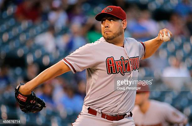 Starting pitcher Vidal Nuno of the Arizona Diamondbacks delivers against the Colorado Rockies at Coors Field on September 18 2014 in Denver Colorado