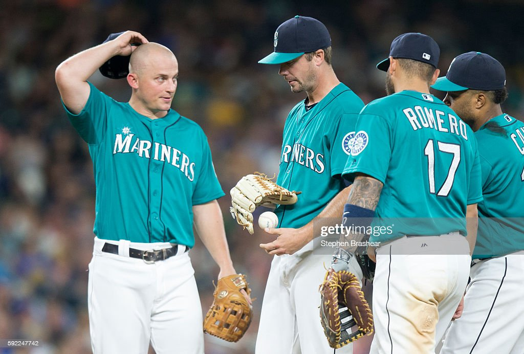 Starting pitcher Wade LeBlanc #35, second from left, of the Seattle Mariners meets at the mound with third baseman Kyle Seager #15, left, first baseman Stefen Romero #17, second from right, and second baseman Robinson Cano #22 of the Seattle Mariners before being pulled during the sixth inning of a game against the Milwaukee Brewers the Seattle Mariners at Safeco Field on August 19, 2016 in Seattle, Washington.