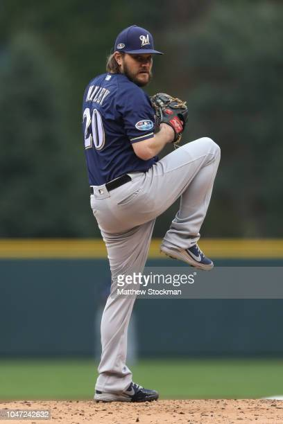 Starting pitcher Wade Miley of the Milwaukee Brewers throws in the first inning of Game Three of the National League Division Series at Coors Field...