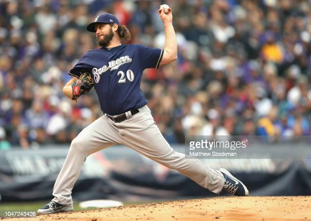 Starting pitcher Wade Miley of the Milwaukee Brewers throws in the third inning of Game Three of the National League Division Series at Coors Field...