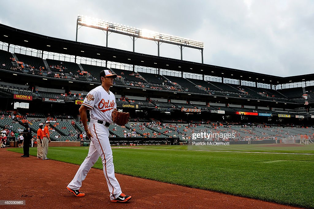 Starting pitcher Wei-Yin Chen #16 of the Baltimore Orioles warms up before the start of a game against the Washington Nationals at Oriole Park at Camden Yards on July 10, 2014 in Baltimore, Maryland.