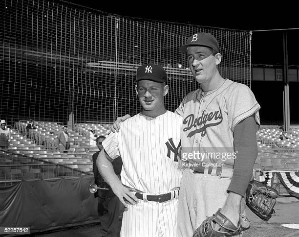 Starting pitcher Whitey Ford of the New York Yankees and Roger Craig of the Brooklyn Dodgers pose for a portrait prior to the start of World Series...