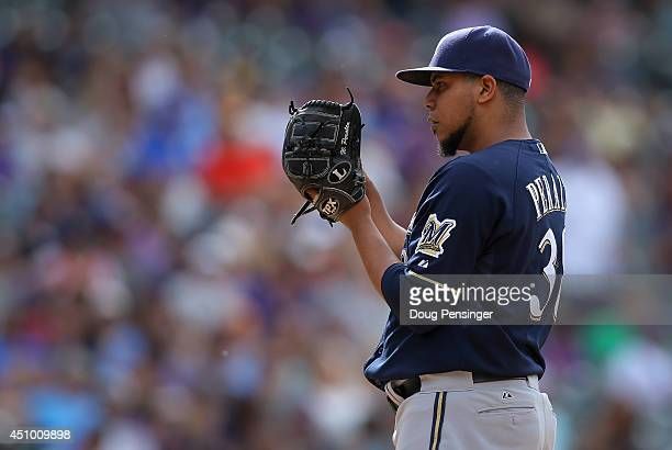 Starting pitcher Wily Peralta of the Milwaukee Brewers works against the Colorado Rockies at Coors Field on June 21 2014 in Denver Colorado Peralta...