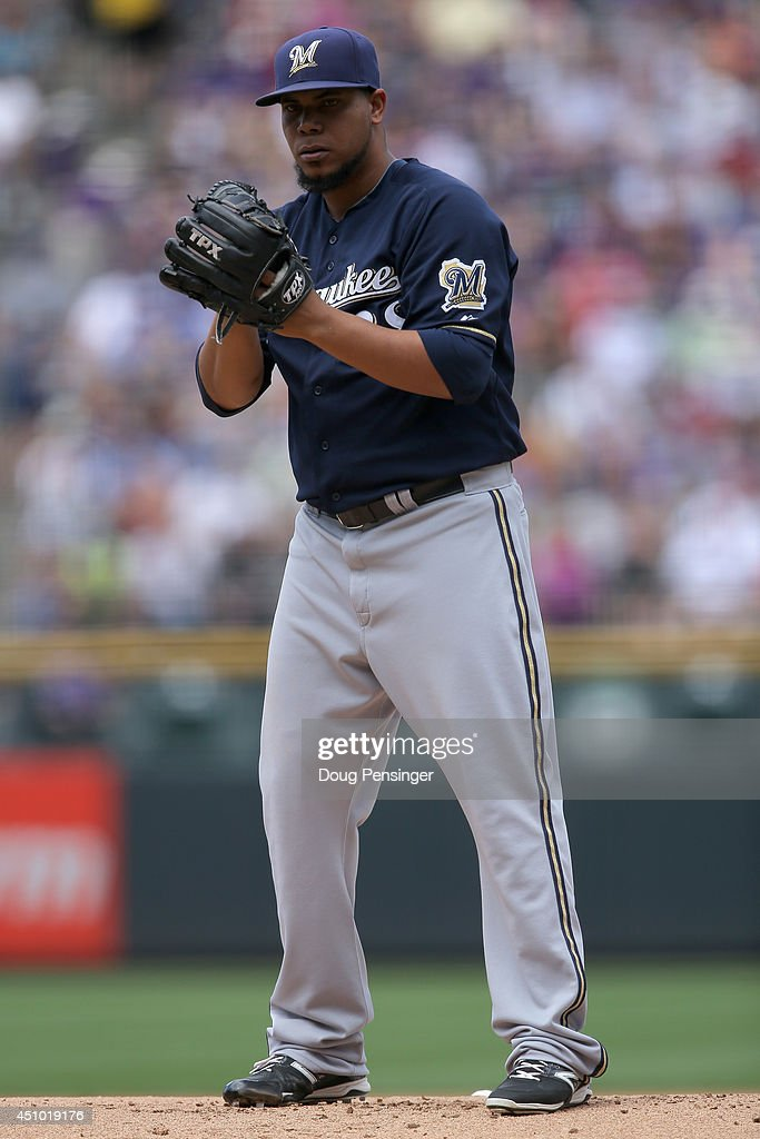 Starting pitcher Wily Peralta #38 of the Milwaukee Brewers works against the Colorado Rockies at Coors Field on June 21, 2014 in Denver, Colorado. Peralta earned the win as the Brewers defeated the Rockies 9-4.
