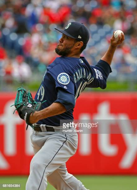 Starting pitcher Yovani Gallardo of the Seattle Mariners throws a pitch in the fourth inning during a game against the Philadelphia Phillies at...