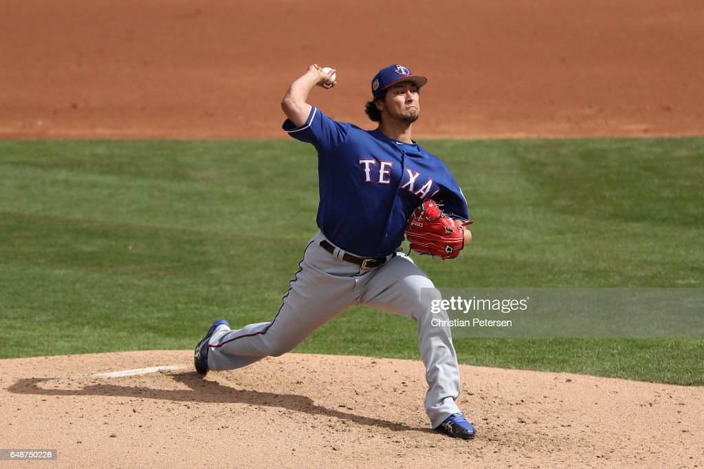 Starting pitcher Yu Darvish #11 of the Texas Rangers pitches against the Kansas City Royals during the second inning of the spring training game at Surprise Stadium on February 26, 2017 in Surprise, Arizona.