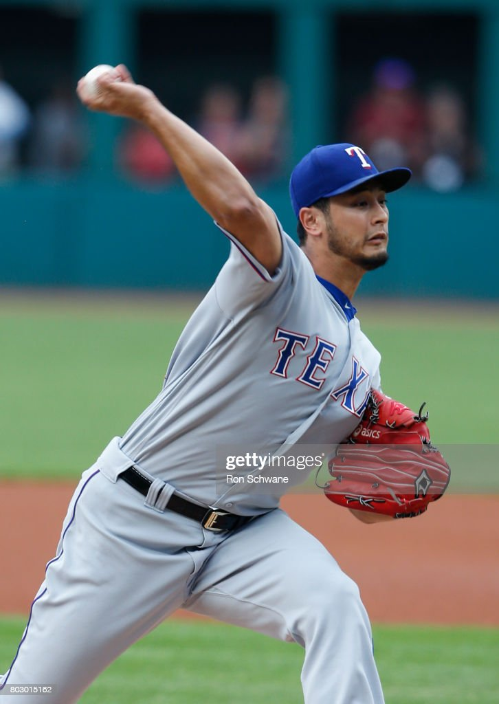 Starting pitcher Yu Darvish #11 of the Texas Rangers pitches against the Cleveland Indians during the first inning at Progressive Field on June 28, 2017 in Cleveland, Ohio.