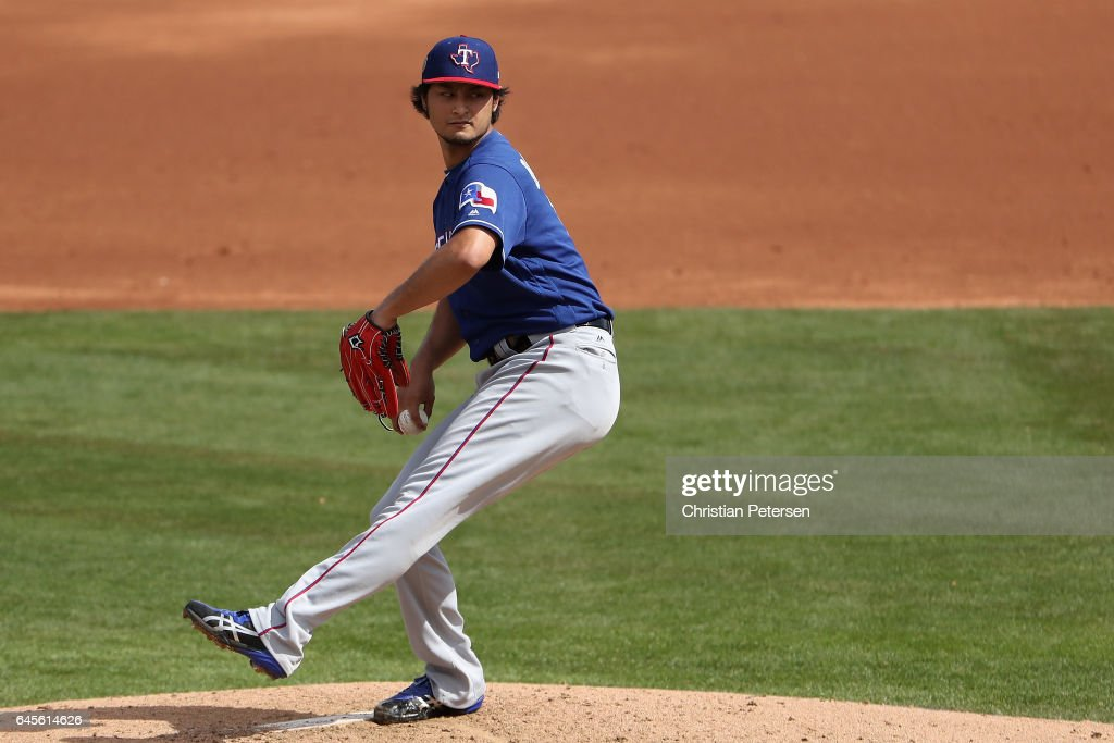 Starting pitcher Yu Darvish #11 of the Texas Rangers throws a pitch against the Kansas City Royals during the spring training game at Surprise Stadium on February 26, 2017 in Surprise, Arizona.