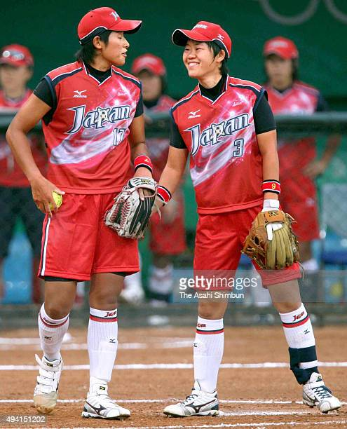 Starting pitcher Yukiko Ueno and Rei Nishiyama of Japan talk during the Softball bronze medal match between Japan and Australia at the Fengtai...