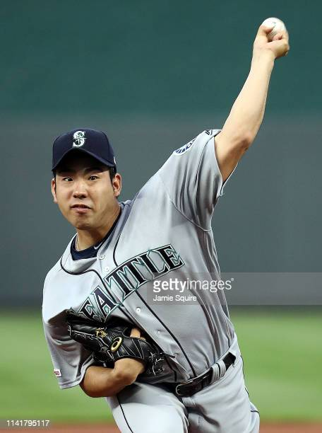 Starting pitcher Yusei Kikuchi of the Seattle Mariners warms up prior to the game against the Kansas City Royals during the game at Kauffman Stadium...