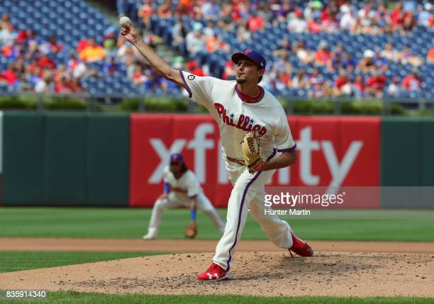 Starting pitcher Zach Eflin of the Philadelphia Phillies throws a pitch during a game against the New York Mets at Citizens Bank Park on August 13...