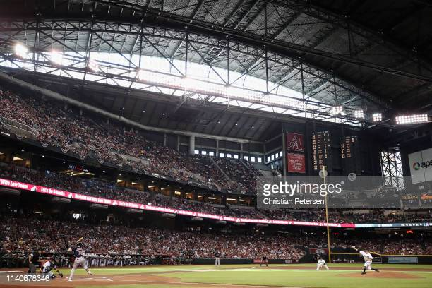 Starting pitcher Zack Godley of the Arizona Diamondbacks throws the first pitch to Andrew Benintendi of the Boston Red Sox during the first inning of...