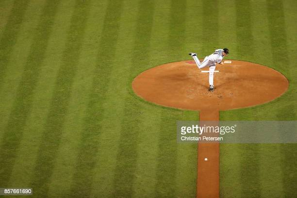 Starting pitcher Zack Greinke of the Arizona Diamondbacks pitches during the top of the first inning of the National League Wild Card game against...