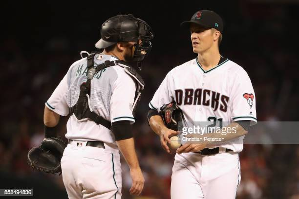 Starting pitcher Zack Greinke of the Arizona Diamondbacks talks with Jeff Mathis during the fourth inning of the National League Wild Card game...