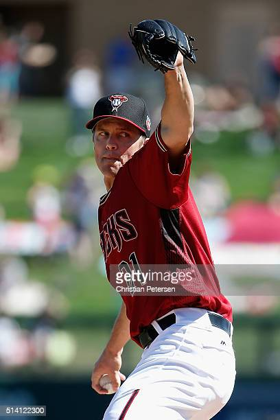 Starting pitcher Zack Greinke of the Arizona Diamondbacks throws a pitch during the first inning of the spring training game against the Oakland...