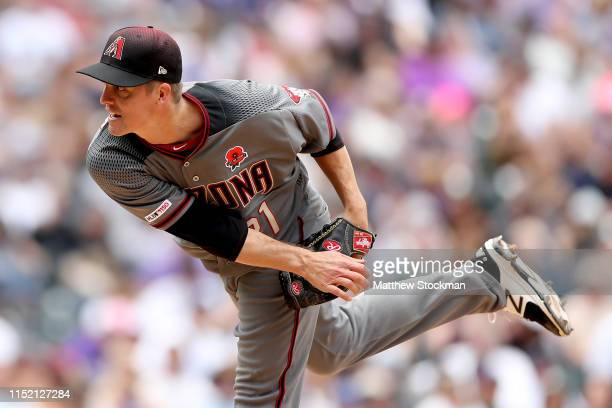 Starting pitcher Zack Greinke of the Arizona Diamondbacks throws in the fifth inning against the Colorado Rockies at Coors Field on May 27 2019 in...