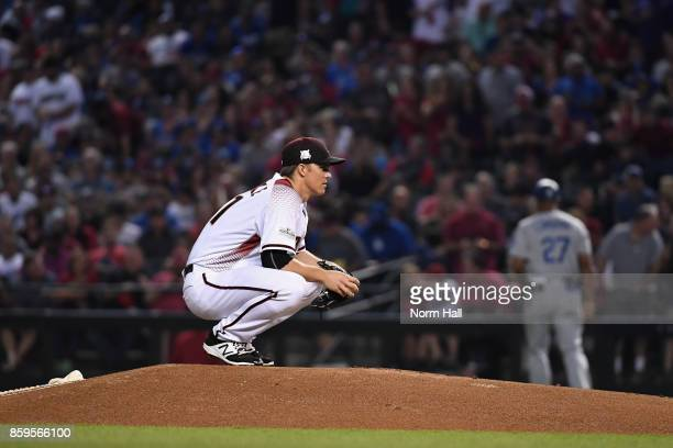 Starting pitcher Zack Greinke of the Arizona Diamondbacks waits to throw during the first inning of the National League Divisional Series game three...
