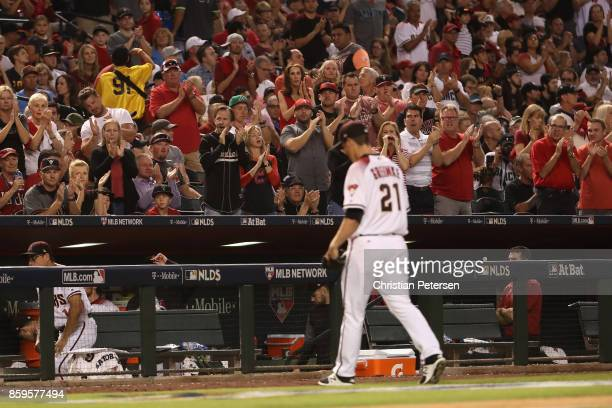 Starting pitcher Zack Greinke of the Arizona Diamondbacks walks off the field after he was removed from the game during the sixth inning of the...