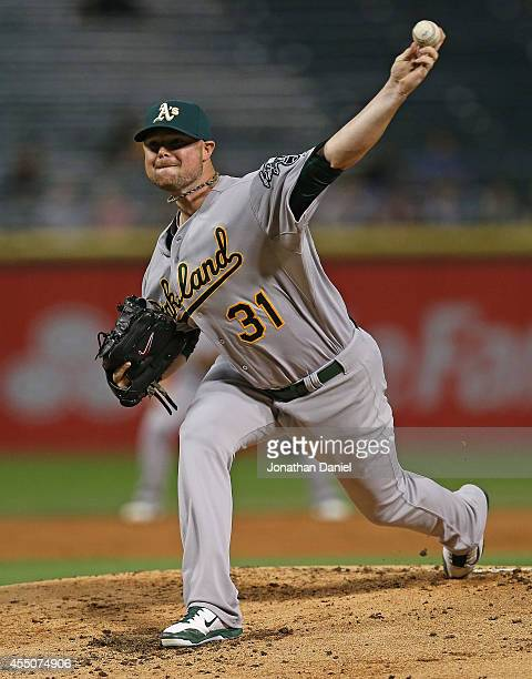 Starting pitcherJon Lester of the Oakland Athletics delivers the ball against the Chicago White Sox at US Cellular Field on September 9 2014 in...