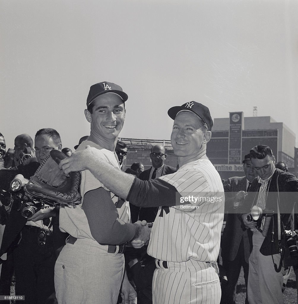 Starting pitchers Whitey Ford (L) of the New York Yankees Sandy Koufax (R) of the Los Angeles Dodgers shake hands before the fourth World Series game.