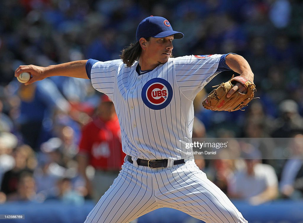 Starting piutcher Jeff Samardzija #29 of the Chicago Cubs delivers the ball  against the Washington