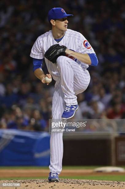 Starting pticher Kyle Hendricks of the Chicago Cubs delivers the ball against the Cincinnati Reds at Wrigley Field on May 17 2017 in Chicago Illinois