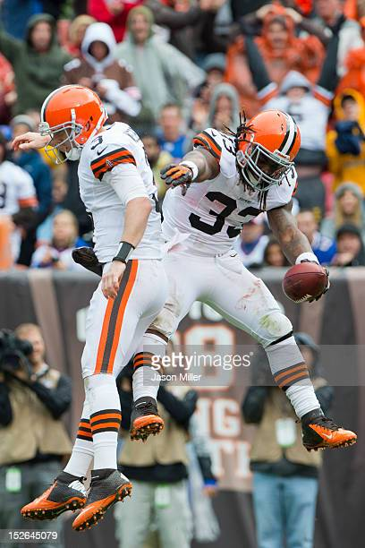 Starting quarterback Brandon Weeden celebrates with running back Trent Richardson of the Cleveland Browns after Richardson scored a touchdown during...