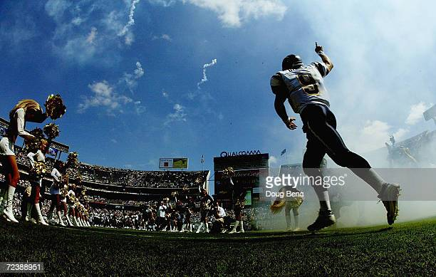 Starting quarterback Drew Brees of the San Diego Chargers enters the stadium last before taking on the New York Jets at Qualcomm Stadium on September...