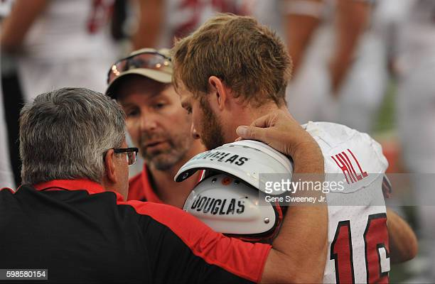 Starting quarterback McCoy Hill of the Southern Utah Thunderbirds is attended to on the bench after a first quarter injury during the game against...