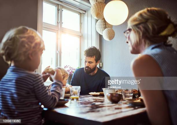 starting their day with breakfast - family stock pictures, royalty-free photos & images