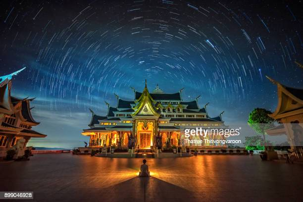 Startrail with Bright Stars and space dust at wat pa phu kon temple, Udon Thani Thailand