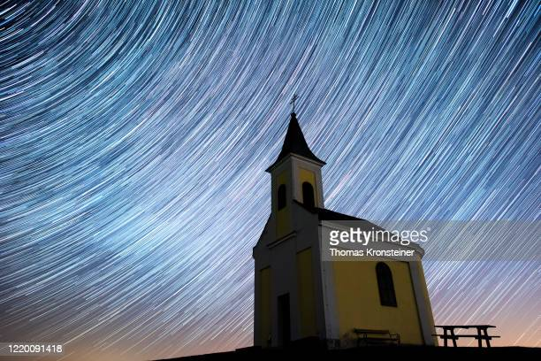 Startrails are seen during the Lyrids meteor shower over Michaelskapelle on April 20, 2020 in Niederhollabrunn, Austria. The clear skies created by...