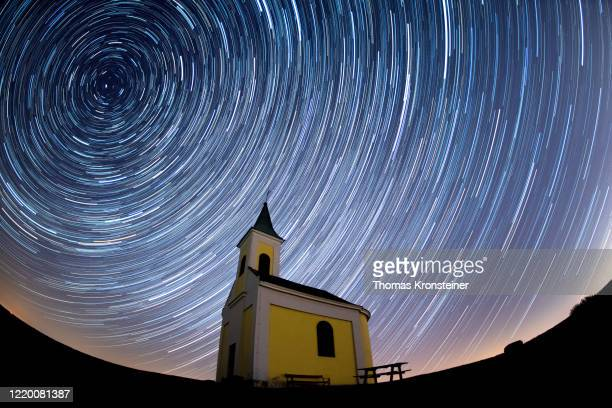 Startrails are seen during the Lyrids meteor shower over Michaelskapelle on April 21, 2020 in Niederhollabrunn, Austria. The clear skies created by...