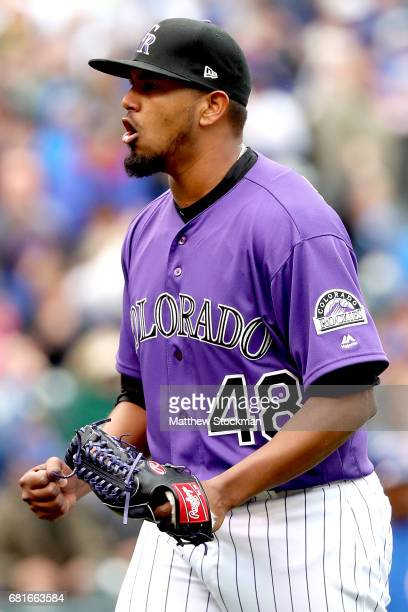 Startung pitcher German Marquez of the Colorado Rockies celebrates as he walks to the dugout after the last out in the top of the eighth inning...