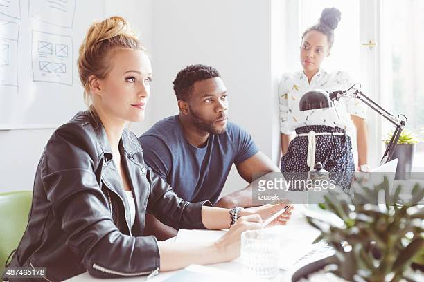 start-up agency, multi ethnic group brainstorming - izusek stock photos and pictures