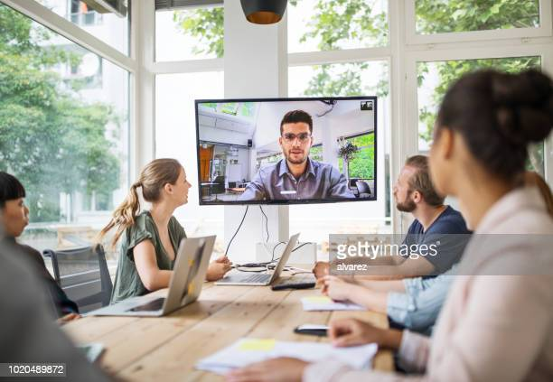 startup business team having a video conference with investor - webinar stock photos and pictures