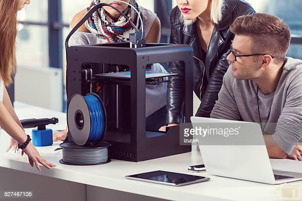 Start-up Business Team working by 3D printer