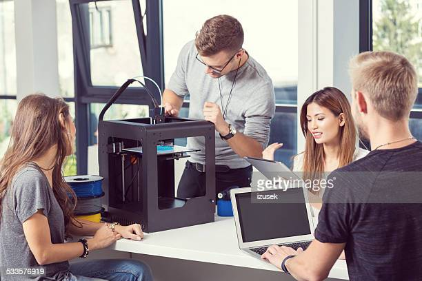 Start-up Business Team working in 3D printer office