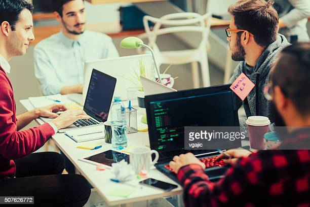 startup programming team. - science and technology stock pictures, royalty-free photos & images