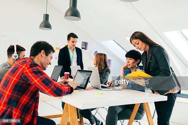 Start-up Team Brainstorming In Their New Office.