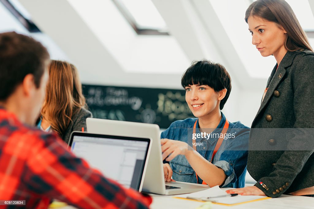 Start-up Team Brainstorming In Their New Office. : Stock Photo