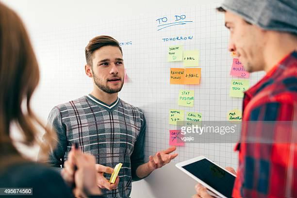 Start-up Team Brainstorming Near Whiteboard.